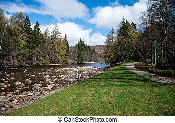 A view of walk path and Dee river in Balmoral Castle estate, Scotland