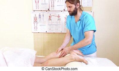 Foots massage girl - Masseur man doing foot massage girl