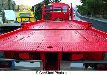 Tow car truck red rear view perspective platform outdoor...