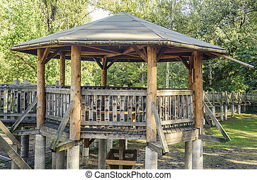 Wooden arbor with bridges of wood. - Wooden arbor with...