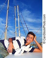 boy teenager vacation laying marina boat smiling summer...