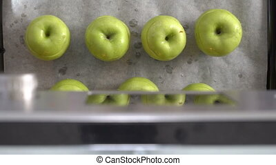 Cooking baked fruit apple dessert in the oven top view. View...