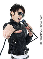 Rock singer - Asian rock singer in performance, isolated on...