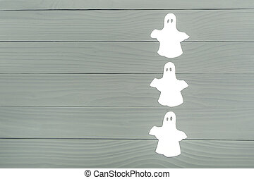 Paper silhouette of three white ghosts - Right side of paper...