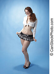 Young and sexy woman dressed in a plaid miniskirt.