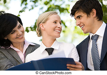 Working together - Portrait of happy people discussing new...