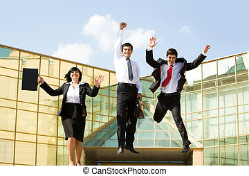 Winners - Portrait of confident business group jumping and...