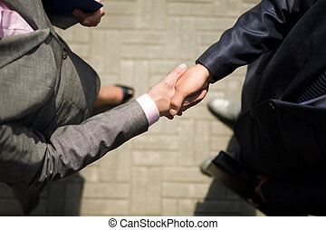 Handshaking - Above view of successful business partners...