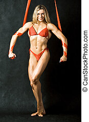 Female bodybuilder - Portrait of strong female in red bikini...