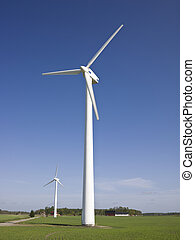 Wind power station towards blue sky