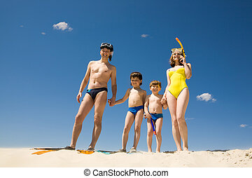 Family of divers - Portrait of modern family in scuba...