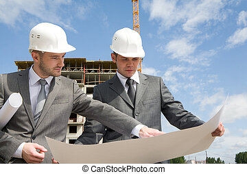 Consulting - Portrait of confident partners looking at new...
