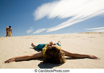Summer pleasure - Image of restful boy lying on sand under...