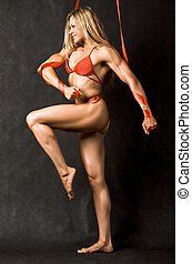 Female bodybuilder - Profile of strong female in red bikini...