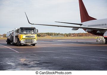 Truck Moving By Airplane On Runway - Truck moving by...