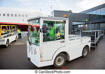 Worker Driving Vehicle On Runway - Male worker driving...