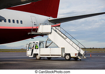 Vehicle By Gangway Attached To Airplane - Vehicle by gangway...
