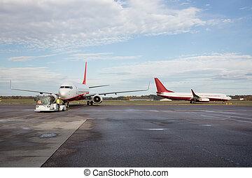 Airplanes On Wet Runway - Airplanes on wet runway at airport...