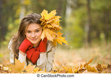 Girl with golden leaves