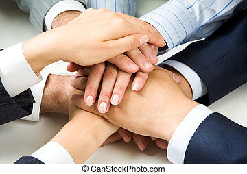 Altogether - Close up of business peoples hands on top of...