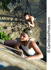 Scramble - Photo of woman climbing on the rock and man...