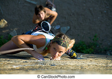 Sport - Photo of woman in sport wear climbing up mountain