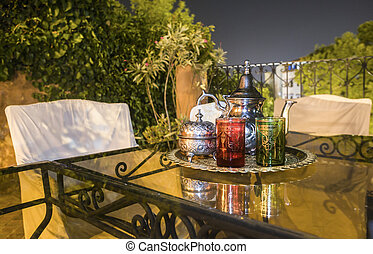Moroccan tea party set up in a warm oriental candlelights...