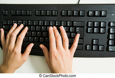 Hands over keyboard - Above view of female hands typing on...