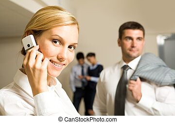 Corporative call - Portrait of blonde woman calling by phone...