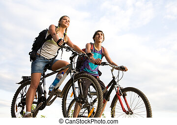 Cyclers - Image of sporty couple on bicycles outdoors...