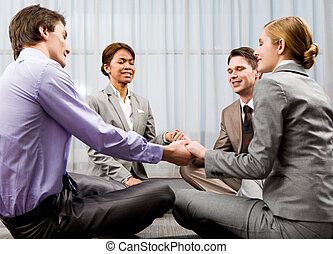 Group pray - Portrait of happy business people sitting on...