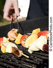 Barbecue fruit skewer on the grill