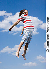 In the air - Portrait of energetic man in high jump against...