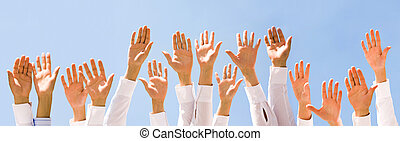 Raised hands - Close-up of several human hands raised...