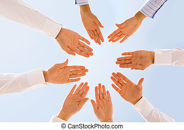 Companionship - Below angle of circle of people hands with...