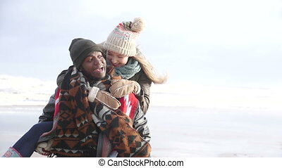 Young Couple Enjoy A Winter Beach - A young couple enjoy a...