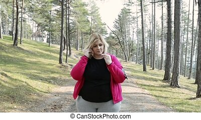 Attractive overweight woman getting ready for a run. -...
