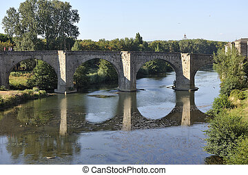 Old stone bridge of Carcassonne leading to the fortified...
