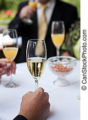 champagne reception - champagne and orange juice on a...
