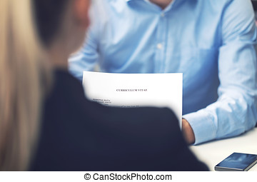 job interview - business woman and candidate at office reading cv