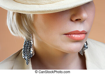 Close up shot of the full lips young blond woman. Studio...