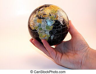 Hand Holding Global World Peace - Hand holding the globe A...