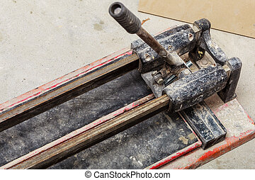 Cutting tiles tool tile cutter closeup - Industrial objects...