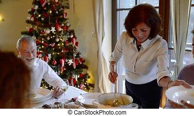 Beautiful big family celebrating Christmas together. -...