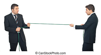 Business men competition - Business men pulling rope in a...