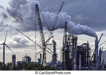 Industrial Pollution - an industrial skyline in Rotterdam -...