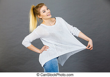 Woman wearing too big jumper, not fitting after weight loss....