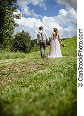 Just married couple walking through the park - Photo of a...