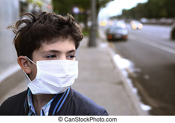 teenager boy in protection mask on the highway city - teen...