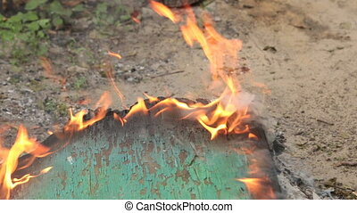 Approximation, zoom of green burning plywood. Environmental...